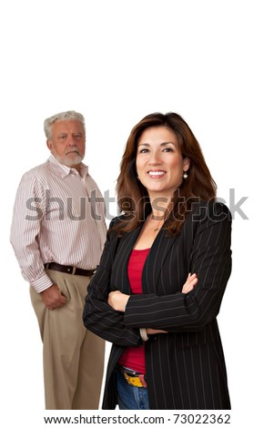 Portrait of pretty smiling businesswoman with out of focus sad looking mature man in background.  Isolated on white.