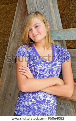 Portrait of Pretty Teen Leaning Against Barn Wood