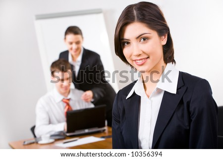 Portrait of pretty white collar worker with brown hair in the office