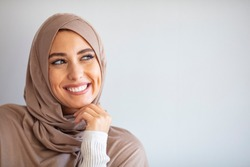 Portrait of pretty young asian muslim woman in head scarf smile. Pearl From The East. Smiling Muslim Woman Wearing Hijab. Modern, Stylish and Happy Muslim Woman Wearing a Headscarf