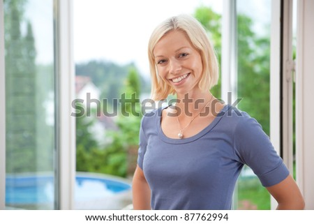 Portrait of pretty young blond woman smiling