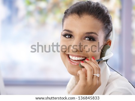 Portrait of pretty young dispatcher, smiling, looking at camera. #136845833