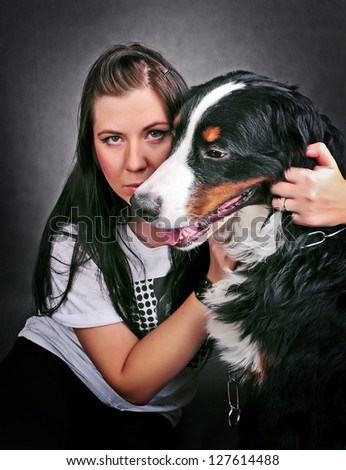 Portrait of Pretty young, happy, woman with her beautiful Bernese mountain dog (Berner Sennenhund)