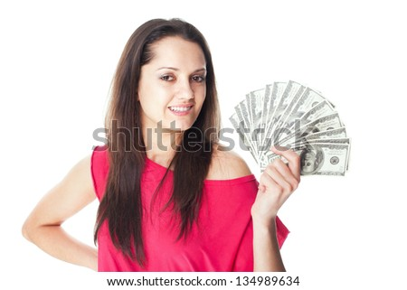 Portrait of pretty young smiling woman holding a dollar bills isolated on white background