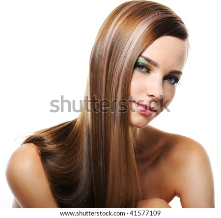 Portrait of pretty young smiling woman with straight long hair
