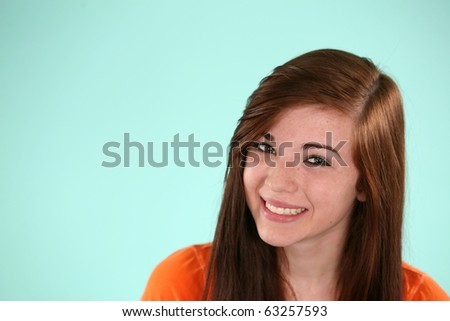 portrait of pretty young teen girl in studio