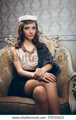 Portrait of pretty young woman in retro style