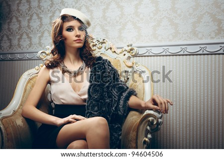 Portrait of pretty young woman in retro style