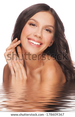 Portrait of pretty young woman with beautiful healthy skin and long brown hair in water. Isolated on white background #178609367