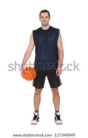 Portrait of professional basketball player. Isolated on white