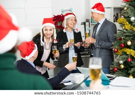 Portrait of professional business team delighted with achievements of joint work on the eve of Christmas #1508744765