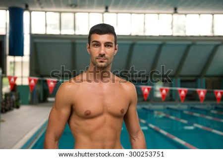Portrait of professional man swimmer inside swimming pool.