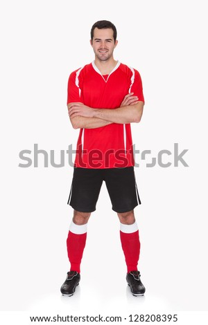 Portrait of professional soccer player. Isolated on white