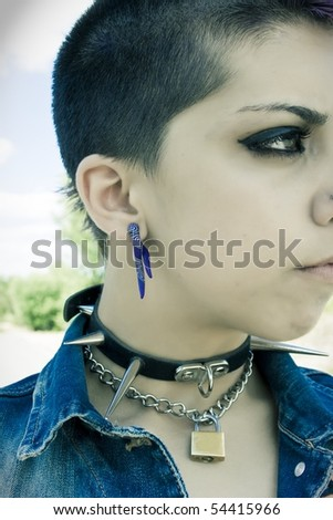 portrait of punk and rebellious girl with spiked additions