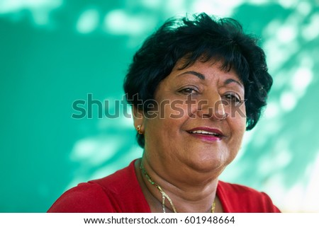 Portrait of real happy Cuban people with emotions, feelings. Latina senior lady smiling, looking at camera. Active retired elderly grandmother. #601948664
