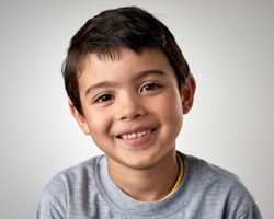 Portrait of real happy mixed race child smiling