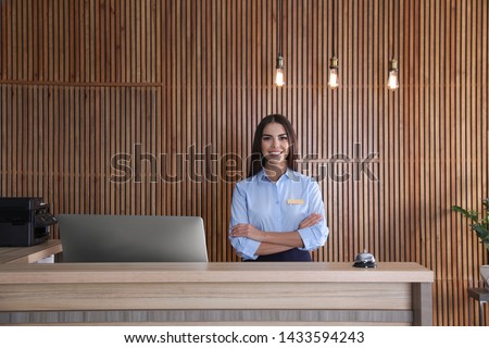 Portrait of receptionist at desk in lobby Stock photo ©