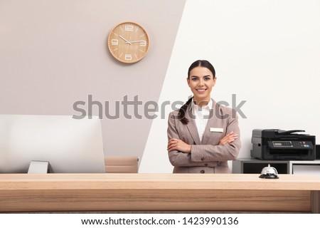 Portrait of receptionist at desk in modern hotel Stock photo ©