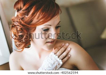 portrait of red-haired young bride, smiling, hand on shoulder. #402562594