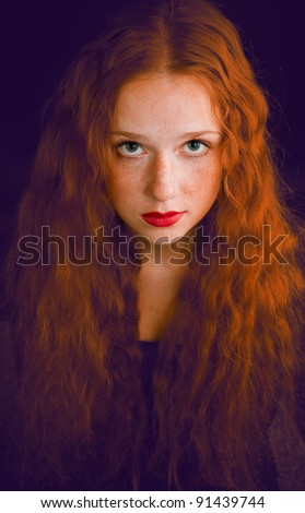 portrait of redheaded beautiful girl on white