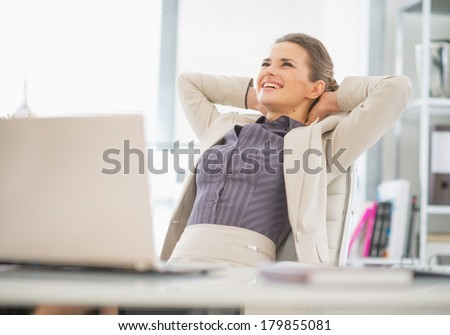 Portrait of relaxed business woman in office #179855081