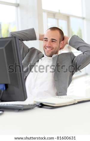 Portrait of relaxed salesman in office