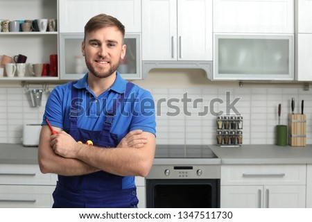 Portrait of repairman with tools near oven in kitchen. Space for text #1347511730