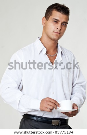 Portrait of resting business man with coffee - stock photo