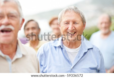 stock photo : Portrait of retired aged man laughing outside with old people