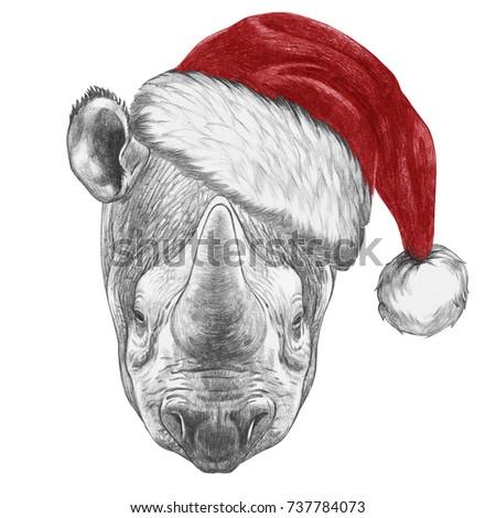 Portrait of Rhinoceros with santa hat. Hand-drawn illustration.