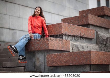 Portrait of rollerskating girl on granite stairs - shallow DOF