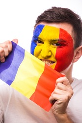 Portrait of Romanian football fan of Romania national team with flag on grey background. European 2016 football fans concept.