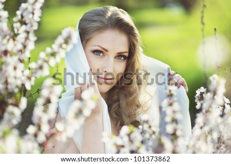 Portrait of romantic blond young woman outdoor