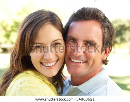 Portrait Of Romantic Couple In Park