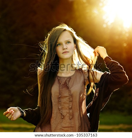Portrait of romantic fashion woman smile in the woods - stock photo