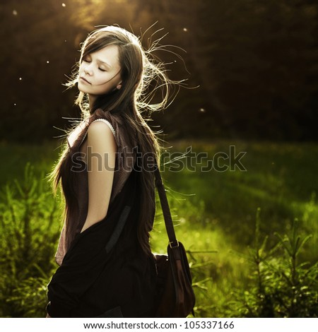 Portrait of romantic fashion woman smile in the woods