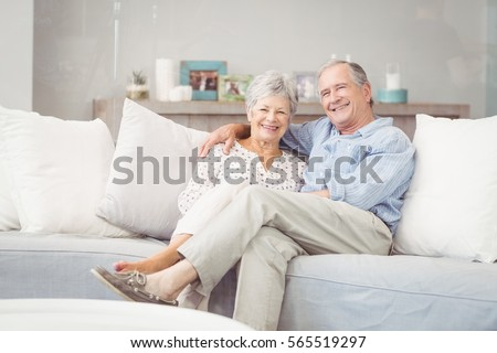 Shutterstock Portrait of romantic senior couple sitting on sofa in living room at home