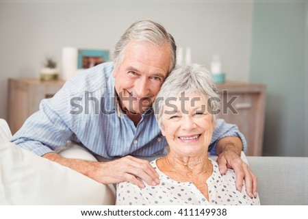 Portrait of romantic senior man with his wife at home