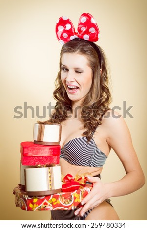 Portrait of romantic sexy young pretty lady having fun emotionally enjoying presents and blinking eye on copy space background