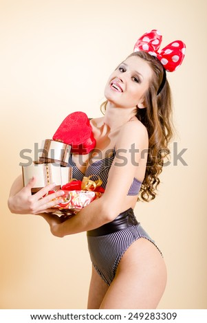 Portrait of romantic sexy young pretty lady having fun emotionally enjoying presents on light copy space background
