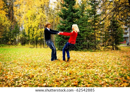 Portrait Of Romantic Young Couple In Autumn Landscape Wirling