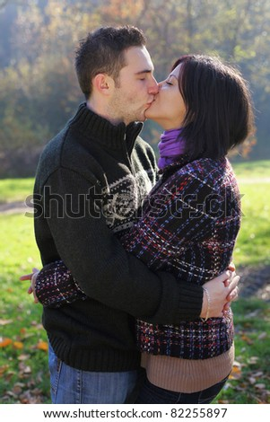 Portrait of romantic young couple in autumn outdoor