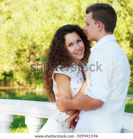 Portrait of romantic young couple in love embracing  in park - love concept