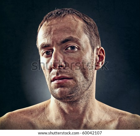 portrait of rough face  man over dark background