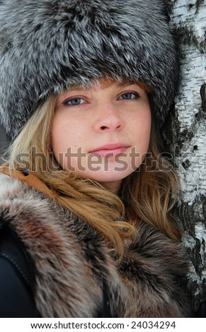 Portrait of russian woman in winter - stock photo