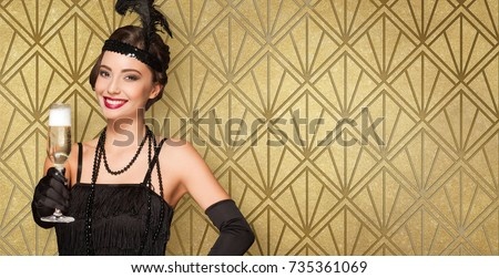 Portrait of 20s style festive beauty with glass of champagne. #735361069