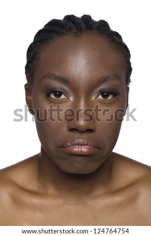 Portrait of sad African woman face against white background