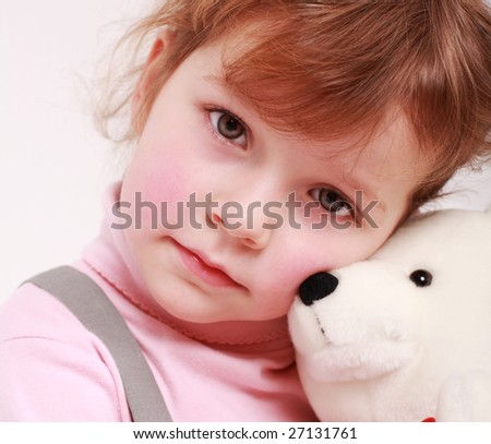 Portrait of sad little girl with teddy