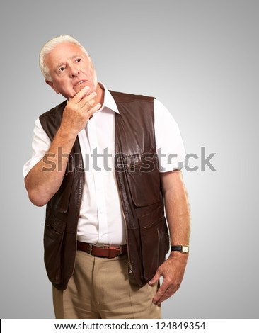 Portrait Of Sad Old Man On Gray Background