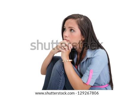portrait of sad pretty girl cuddling on the floor - stock photo